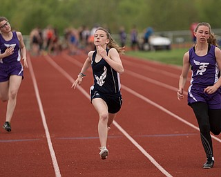 From left, Seb. McKinley's Mary Quinn, McDonald's Anastasia Christiansen, and Seb. McKinley's Kalyn Mudrick compete in the first section of the Girls 100 Meter Dash at the Mahoning Valley Athletic Conference High School League Championship Meet at Western Reserve High School on Thursday. Christiansen finished in first. EMILY MATTHEWS   THE VINDICATOR