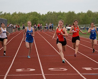 From left, Jackson Milton's Bailey Estes, Western Reserve's Kayla Owen, Springfield's Mary Grace Mason, Mineral Ridge's Josie Shultz, and Western Reserve's Natel Smith compete in the second section of the Girls 100 Meter Dash at the Mahoning Valley Athletic Conference High School League Championship Meet at Western Reserve High School on Thursday. Mason finished in first. EMILY MATTHEWS   THE VINDICATOR