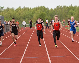From left, Jackson Milton's Sean Lengyel, McDonald's Dominic Scbadl, Mineral Ridge's John Beshara, Springfield's, Zach Ebert, Springfield's Garrett Walker, Western Reserve's Jimmy Mayberry, Mineral Ridge's Triston Weiss, and Waterloo's Joe Thomas compete in the second section of the Boys 100 Meter Dash at the Mahoning Valley Athletic Conference High School League Championship Meet at Western Reserve High School on Thursday. Walker finished in first. EMILY MATTHEWS   THE VINDICATOR