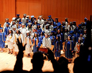 The audience watches as the Youngstown Rayen Early College Class of 2019 files into DeYor 's Ford Recital Hall for their commencement ceremony on Friday. EMILY MATTHEWS | THE VINDICATOR