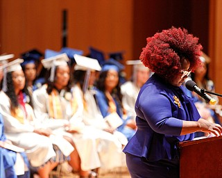 Monica Jones, the dean of Youngstown Rayen Early College, gives opening remarks during the Class of 2019 commencement ceremony in DeYor 's Ford Recital Hall on Friday. EMILY MATTHEWS | THE VINDICATOR