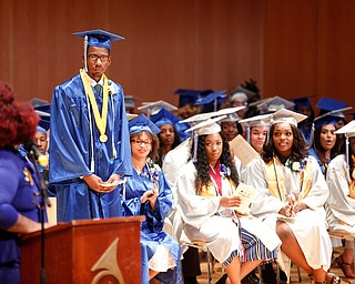Jaheem Hughes, the valedictorian of the Youngstown Rayen Early College Class of 2019, is recognized during the commencement ceremony in DeYor 's Ford Recital Hall on Friday. EMILY MATTHEWS | THE VINDICATOR