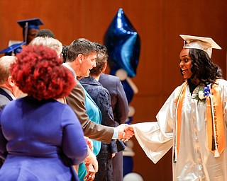 Kaia Anderson shakes hands with staff members before receiving her diploma during the Youngstown Rayen Early College Class of 2019 commencement ceremony in DeYor's Ford Recital Hall on Friday. EMILY MATTHEWS | THE VINDICATOR