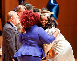 Kaia Anderson hugs Monica James, the dean of Youngstown Rayen Early College, as she receives her diploma during the Youngstown Rayen Early College Class of 2019 commencement ceremony in DeYor's Ford Recital Hall on Friday. EMILY MATTHEWS | THE VINDICATOR