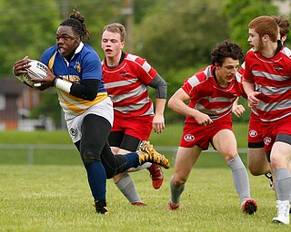 YOUNGSTOWN, OHIO - May 10, 2019: Rugby- Northwest Indians vs East Golden Bears. East Golden Bears' Dmarcus Carr (12, with ball) runs away from Northwest Indians' defense to score during the 1st half at Rayen Stadium. Photo by MICHAEL G. TAYLOR | THE VINDICATOR