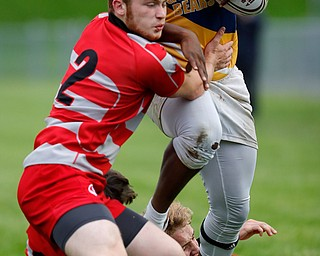 YOUNGSTOWN, OHIO - May 10, 2019: Rugby- Northwest Indians vs East Golden Bears.  East Golden Bears' Jarall Jenkins (10, right) still arms Northwest Indians' Dean Hutzell (2) during the 1st half at Rayen Stadium. Photo by MICHAEL G. TAYLOR | THE VINDICATOR