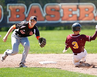 Springfield's Drew Clark attempts to catch the ball as South Range's Trey Pancake slides in to second for a steal during their game on Saturday at Springfield High School. Springfield won in the 10th inning 9-8. EMILY MATTHEWS | THE VINDICATOR