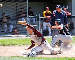 The ball gets past South Range catcher's Trey Pancake as Springfield's Shane Eynon slides in to score during their game on Saturday at Springfield High School. Springfield won in the 10th inning 9-8. EMILY MATTHEWS | THE VINDICATOR