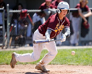 South Range's Luke Blasko goes for a bunt during their game against Springfield on Saturday at Springfield High School. Springfield won in the 10th inning 9-8. EMILY MATTHEWS | THE VINDICATOR