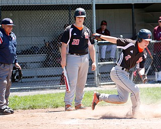 Springfield's Chris Thompson (20) steps out of the box as NIck Slike steals home during their game against South Range on Saturday at Springfield High School. Springfield won in the 10th inning 9-8. EMILY MATTHEWS | THE VINDICATOR