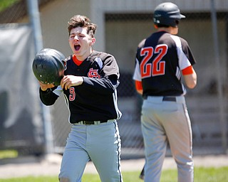 Springfield's Nate LaBoy celebrates after scoring during the seventh inning of their game against South Range on Saturday at Springfield High School. Springfield won in the 10th inning 9-8. EMILY MATTHEWS | THE VINDICATOR