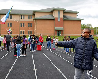 Sedric Woods, 15, a ninth grader at Chaney High School, flies a kite during a fundraiser for Save the Children, an organization that helps child refugees, on the track at Chaney High School on Tuesday afternoon. EMILY MATTHEWS | THE VINDICATOR