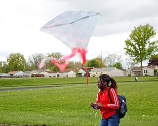 Alaja Johnson, 17, an 11th grader at Chaney High School, flies a kite during a fundraiser for Save the Children, an organization that helps child refugees, on the track at Chaney High School on Tuesday afternoon. EMILY MATTHEWS | THE VINDICATOR