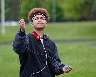Luis Vazquez, 18, an 11th grader at Chaney High School, flies a kite during a fundraiser for Save the Children, an organization that helps child refugees, on the track at Chaney High School on Tuesday afternoon. EMILY MATTHEWS | THE VINDICATOR