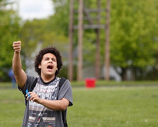 Christian Bermudez, 16, a 10th grader at Chaney High School, flies a kite during a fundraiser for Save the Children, an organization that helps child refugees, on the track at Chaney High School on Tuesday afternoon. EMILY MATTHEWS | THE VINDICATOR