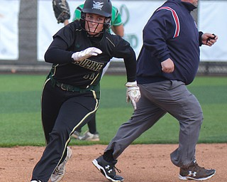 William D. Lewis The Vindicator  Ursuline's Julia Nutter(17) rounds 3rd to score duirng 1rst inning of 5-14-19 game with West branch at YSU.