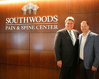 Ed Muransky, left, and Josh Thompson stand in the reception area of the new Southwoods Pain and Spine Center on Monday morning. EMILY MATTHEWS | THE VINDICATOR