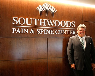 Ed Muransky stands in the reception area of the new Southwoods Pain and Spine Center on Monday morning. EMILY MATTHEWS | THE VINDICATOR