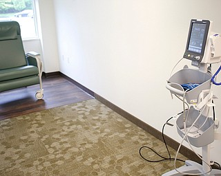 An infusion pump is used to take vitals and administer medicine in the infusion suite of the new Southwoods Pain and Spine Center on Monday morning. EMILY MATTHEWS | THE VINDICATOR