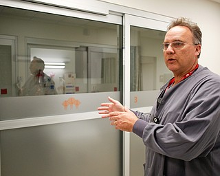 Mark Paczak, a registered nurse and the director of pain management in the new Southwoods Pain and Spine Center, talks about how the fogged doors of patients' rooms provide patients with privacy on Monday morning. EMILY MATTHEWS | THE VINDICATOR