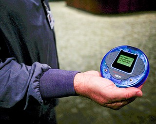 Mark Paczak, a registered nurse and the director of pain management in the new Southwoods Pain and Spine Center, holds a pager that vibrates and lights up to signal to waiting patients to come to the front desk. EMILY MATTHEWS | THE VINDICATOR
