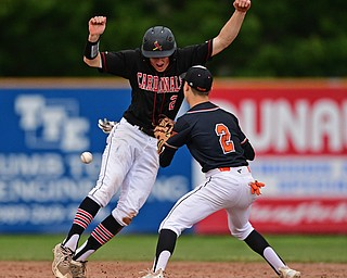 STRUTHERS, OHIO - MAY 15, 2019: Howland's Gage Tomko loses possession of the ball while attempting to tag out Canfield's Brent Herrmann after he was caught in a rundown in the second inning of Wednesday nights OHSAA Tournament game at Cene Park. DAVID DERMER | THE VINDICATOR