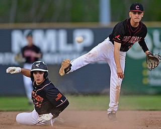 STRUTHERS, OHIO - MAY 15, 2019: Canfield's Michael Buddle, right, looks to first after forcing out Howland's Joey Peefelte at second base in the third inning of Wednesday nights OHSAA Tournament game at Cene Park. The Howland runner would be ace at first base. DAVID DERMER | THE VINDICATOR