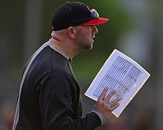 STRUTHERS, OHIO - MAY 15, 2019: Canfield head coach Gary Knittle talks near the dugout in the fourth inning of Wednesday nights OHSAA Tournament game at Cene Park. The Howland runner would be ace at first base. DAVID DERMER | THE VINDICATOR