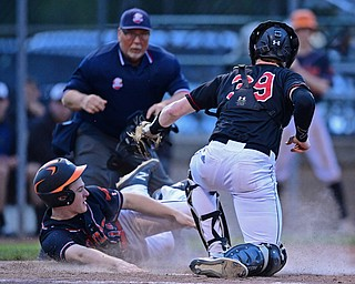 STRUTHERS, OHIO - MAY 15, 2019: Howland's Ian Meekel is tagged out by Canfield's Danny Beistel in the fourth inning of Wednesday nights OHSAA Tournament game at Cene Park. The Howland runner would be ace at first base. DAVID DERMER | THE VINDICATOR