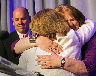 William D. Lewis The Vindicator   2019 Athena winner Dr. Tammy King, right, hugs Dr. Betty Jo Licata, MC of program. At left is James Dignan, CEO of regional Chamber.