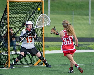 Cardinal Mooney goalkeeper Annie Driscoll attempts to stop a shot from Paige Christoff of Canfield in a Division II tournament game at Don Bucci Field on Thursday