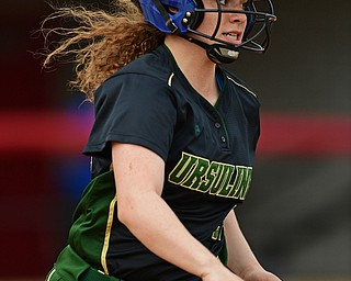 YOUNGSTOWN, OHIO - MAY 16, 2019: Ursuline's Alyssa Sheely runs to first after hitting a single in the sixth inning of Thursday afternoons OHSAA Tournament game at Youngstown State University. Poland won 7-6. DAVID DERMER | THE VINDICATOR