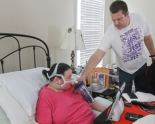 William D. Lewis The Vindicator  Brian Terslesky gives his wife Christine a drink of water in hter Boardman home 4-4-19, She has ALS.