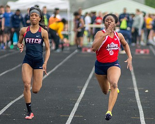 Chante Clinkscale of Niles McKinley (right) outduels Alena Williams of Austintown Fitch in the 100-meter dash in the Division I District Track and Field Meet at Greenwood Chevrolet Falcon Stadium on Friday night.
