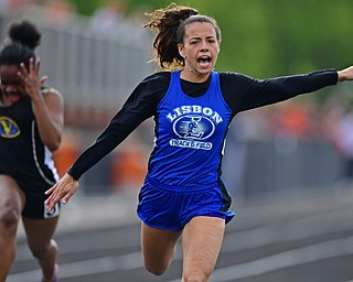 NEW SPRINGFIELD, OHIO - MAY 17, 2019: Lisbon's Izzy Perez races to the finish line ahead of Valley Christian's Kennedy Tucker during the girls 100 meter dash, Friday night during the Division III District Track Meet at Springfield High School. DAVID DERMER | THE VINDICATOR
