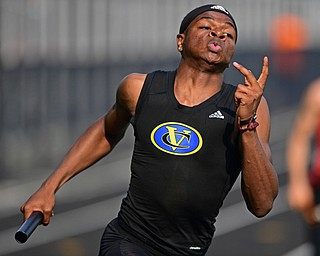 NEW SPRINGFIELD, OHIO - MAY 17, 2019: Valley Christian's Tyrone Lindsey takes off after receiving the baton during the boys 4x200 meter relay, Friday night during the Division III District Track Meet at Springfield High School. DAVID DERMER | THE VINDICATOR