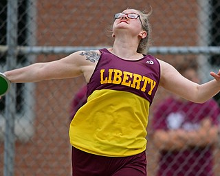 NEW SPRINGFIELD, OHIO - MAY 17, 2019: Liberty's Molly Young competes during the girls discus, Friday night during the Division III District Track Meet at Springfield High School. DAVID DERMER | THE VINDICATOR