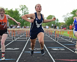 NEW SPRINGFIELD, OHIO - MAY 17, 2019: McDonald's Naomi Domitrovich crosses the finish line ahead of the other racers to win the girls 100 meter hurdles, Friday night during the Division III District Track Meet at Springfield High School. DAVID DERMER | THE VINDICATOR