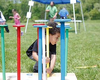 Noah Axel, 3, of Poland, plays with an oversized peg set at Kids to Parks Day at Ipe Field on Saturday afternoon. EMILY MATTHEWS | THE VINDICATOR