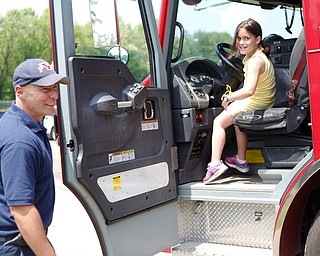Mya Niznik, 6, of Struthers, tries to convince Lt. Bill Palma to let her drive the Youngstown firetruck at Kids to Parks Day at Ipe Field on Saturday afternoon. EMILY MATTHEWS | THE VINDICATOR