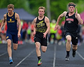 CORTLAND, OHIO - MAY 18, 2019: Girard's Nicolas Malito, right, runs to the finish line with Garfield's Devyn Penna and Streetsboro's Ethan Schuster during the boys 100 meter dash, Saturday morning during the Division II District Track Meet at Lakeview High School. DAVID DERMER | THE VINDICATOR
