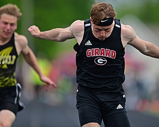 CORTLAND, OHIO - MAY 18, 2019: Girard's Nicolas Malito crosses the finish line to win the boys 100 meter dash, Saturday morning during the Division II District Track Meet at Lakeview High School. DAVID DERMER | THE VINDICATOR