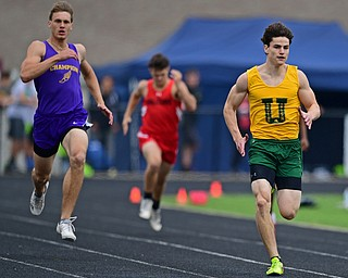 CORTLAND, OHIO - MAY 18, 2019: Ursuline's Zach Simon runs ahead of Champion's Cody Lamb during the boys 200 meter dash, Saturday morning during the Division II District Track Meet at Lakeview High School. DAVID DERMER | THE VINDICATOR
