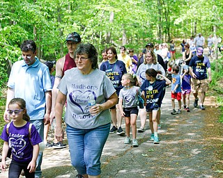 Madison Himes, 6, of New Middletown, who has cystic fibrosis, walks with, from left, her uncle Aaron Mehocic, cousin James Holliday, both of New Castle, Pa., and grandmother Claudia Mehocic, of Pulaski, in the 20th annual Mahoning/Trumbull Great Strides cystic fibrosis walk at Boardman Park on Sunday afternoon. EMILY MATTHEWS   THE VINDICATOR