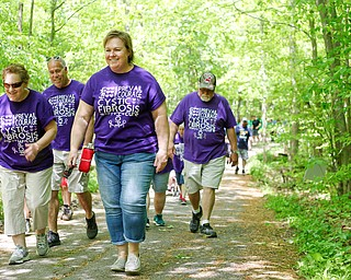 From left, Chris Davis, of Struthers, Brad Davis, of Struthers, Cathy Cunningham, of Elyria, and Paul Schmidt, of Canfield, walk for Schmidt's grandson Colt, who has cystic fibrosis, in the 20th annual Mahoning/Trumbull Great Strides cystic fibrosis walk at Boardman Park on Sunday afternoon. EMILY MATTHEWS   THE VINDICATOR