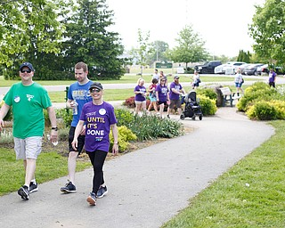 Chrissy Falleti, right, who has cystic fibrosis, walks with her husband Joe Falleti, left, and her cousin Nick Novosel, all of Liberty, in the 20th annual Mahoning/Trumbull Great Strides cystic fibrosis walk at Boardman Park on Sunday afternoon. EMILY MATTHEWS   THE VINDICATOR