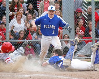 William D. Lewis The Vindictor Poland's catcher MJ Farber(25) tags Niles' Brandon Hayes(12) as Poland's Alex Barth(2) reacts during game ending play. Poland won 8-7.