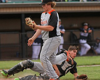 William D. Lewis the vindicator  Sprinfield pitcher Chris Thompson and catcher Jarrett Orbin(8) collide while trying to catch an infield popup.