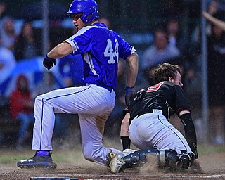 STRUTHERS, OHIO - MAY 22, 2019: Poland's Zachary Yaskulka scores a run beating a tag from Canfield's Danny Beistel in the second inning of their OHSAA Tournament game, Wednesday night at Cene Park. DAVID DERMER | THE VINDICATOR