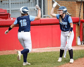 Hillsdale's Molly Moffett, left, and Payton Fickes high-five after Moffett scores during their game against Bristol at Firestone Stadium in Akron on Thursday. EMILY MATTHEWS | THE VINDICATOR